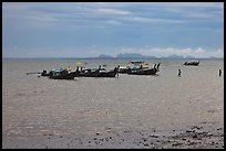 Boats anchored at low tide, storm sky,  Railay East. Krabi Province, Thailand