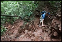 Hiker on steep trail, Laem Phra Nang, Rai Leh. Krabi Province, Thailand (color)