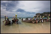 Long tail boats on beach, Hat Rai Leh West. Krabi Province, Thailand (color)