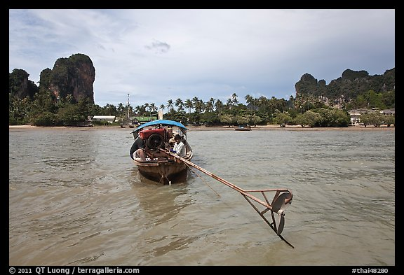 Tail of boat, and Railay East. Krabi Province, Thailand (color)
