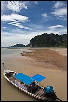 Boat and cliffs, Ao Nammao. Krabi Province, Thailand (color)