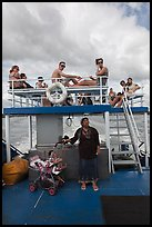 Local woman and tourists on boat, Adaman Sea. Krabi Province, Thailand ( color)