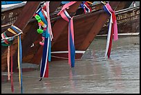 Prows of longtail boats with garlands, Ko Phi-Phi Don. Krabi Province, Thailand (color)