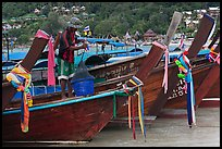 Row of boats, fisherman standing, Ko Phi Phi. Krabi Province, Thailand ( color)