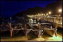 Long tail boats and pier at night, Ko Phi Phi. Krabi Province, Thailand (color)