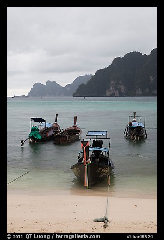 Beach and longtail boats in rainy weather, Ao Ton Sai, Ko Phi Phi. Krabi Province, Thailand (color)