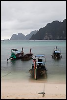 Beach and longtail boats in rainy weather, Ao Ton Sai, Ko Phi Phi. Krabi Province, Thailand