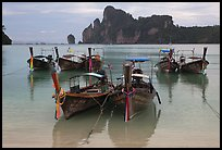 Tranquil waters of Ao Lo Dalam bay with longtail boats, Phi-Phi island. Krabi Province, Thailand (color)