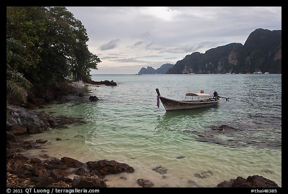 Boat, clear water, stormy skies, Phi-Phi island. Krabi Province, Thailand (color)