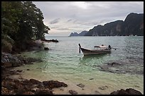 Boat, clear water, stormy skies, Phi-Phi island. Krabi Province, Thailand ( color)
