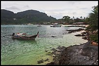 Long tail boat, and Tonsai village, Ko Phi-Phi Don. Krabi Province, Thailand ( color)