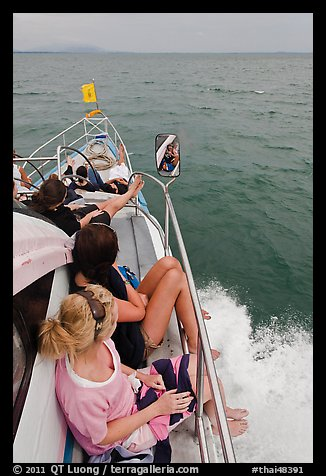 Women sitting on front of boat. Krabi Province, Thailand (color)