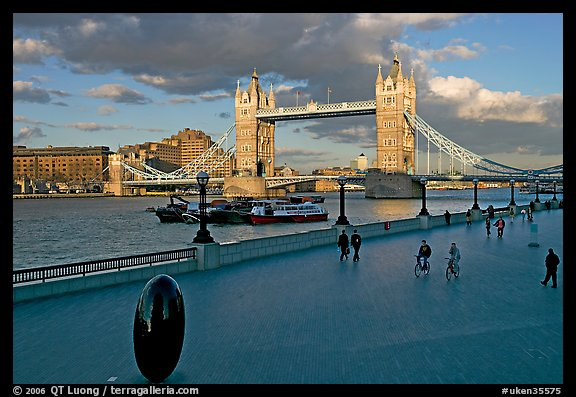 Waterfront promenade in the more London development and Tower Bridge, late afternoon. London, England, United Kingdom (color)