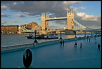 Waterfront promenade in the more London development and Tower Bridge, late afternoon. London, England, United Kingdom ( color)