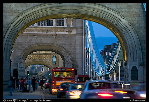Arches and car traffic on the Tower Bridge at nite. London, England, United Kingdom