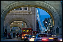 Arches and car traffic on the Tower Bridge at nite. London, England, United Kingdom (color)
