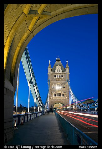 Walkway and road traffic on the Tower Bridge at night. London, England, United Kingdom