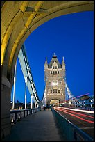 Walkway and road traffic on the Tower Bridge at night. London, England, United Kingdom (color)