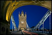 Arch and car traffic on the Tower Bridge at night. London, England, United Kingdom (color)