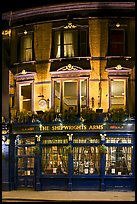 Building housing the pub Shipwrights Arms at night. London, England, United Kingdom