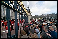 Crowds at the grids in front of Buckingham Palace watching the changing of the guard. London, England, United Kingdom (color)