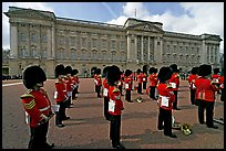 Rows of guards  wearing bearskin hats and red uniforms. London, England, United Kingdom