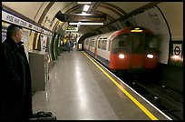 Man waiting for approaching train at Hyde Park subway station. London, England, United Kingdom (color)