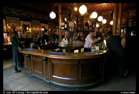 Pouring beer from hand-pulled pump, pub Princess Louise. London, England, United Kingdom