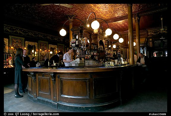 Central horseshoe bar in the 19th century victorian  pub Princess Louise. London, England, United Kingdom