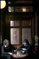 Young men, beer pints, and etched glass, pub Princess Louise. London, England, United Kingdom (color)