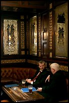 Business men talking over a beer, Victorian boozer Princess Louise. London, England, United Kingdom