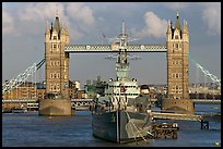 HMS Belfast cruiser and Tower Bridge, late afternoon. London, England, United Kingdom (color)