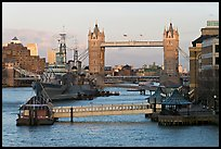Historic boats, quays along the Thames, and Tower Bridge, late afternoon. London, England, United Kingdom ( color)