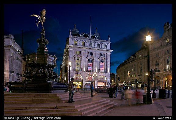 Piccadilly Circus and Eros statue at night. London, England, United Kingdom