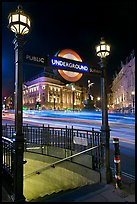 Underground  entrance and lights from traffic at night, Piccadilly Circus. London, England, United Kingdom (color)