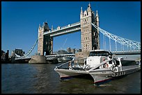 Fast catamaran cruising the Thames, with Tower Bridge in the background. London, England, United Kingdom ( color)