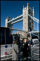 Passengers disembarking a boat in their morning commute, Tower Bridge in the background. London, England, United Kingdom ( color)