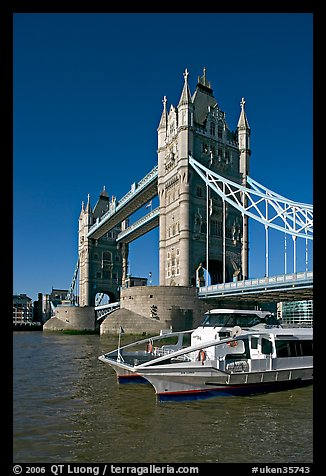Catamaran below Tower Bridge. London, England, United Kingdom