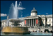 Fountain and National Gallery, Trafalgar Square, mid-day. London, England, United Kingdom