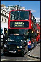 Taxi and double decker bus. London, England, United Kingdom ( color)