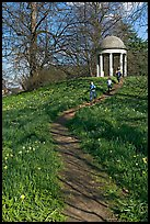 Children running down a trail leading to gazebo. Kew Royal Botanical Gardens,  London, England, United Kingdom (color)