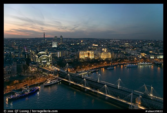 Aerial view of Charing Cross Station, Hungerford Bridge and Golden Jubilee Bridges at sunset. London, England, United Kingdom
