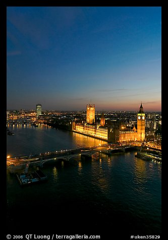 Aerial view of Thames River and Houses of Parliament at dusk. London, England, United Kingdom (color)