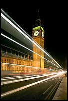 Lights from a moving bus, Houses of Parliament, and Big Ben at night. London, England, United Kingdom