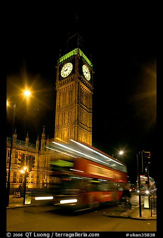 Big Ben and double decker bus in motion at nite. London, England, United Kingdom