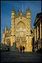 West facade of Bath Abbey with couple silhouette, late afternoon. Bath, Somerset, England, United Kingdom ( color)