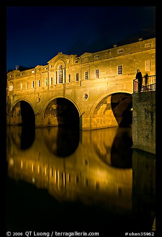 Man looking at the Pulteney Bridge  at night. Bath, Somerset, England, United Kingdom (color)