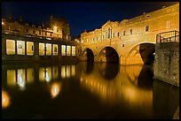 Pulteney Bridge, and quay reflected in River Avon at night. Bath, Somerset, England, United Kingdom (color)