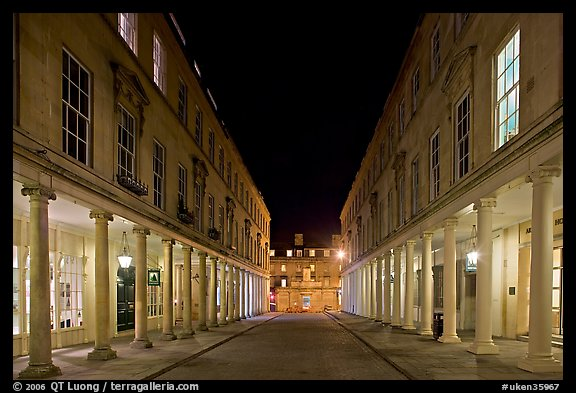 Street bordered by colonades at night. Bath, Somerset, England, United Kingdom