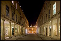 Street bordered by colonades at night. Bath, Somerset, England, United Kingdom (color)